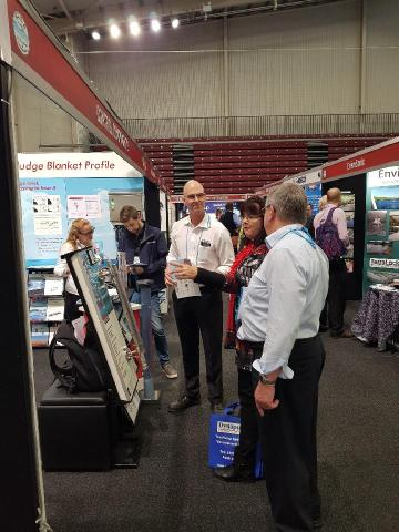 Leaner of the Year Cathy Hocking discusses a tradeshow booth at the QLD WIOA conference